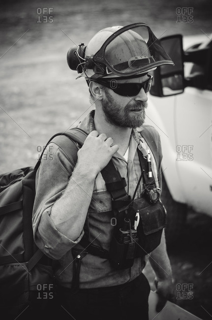 Alberta, British Colombia, Canada - July 12, 2015: Black and white portrait of male Panorama Crew Services member, Alberta, British Colombia, Canada