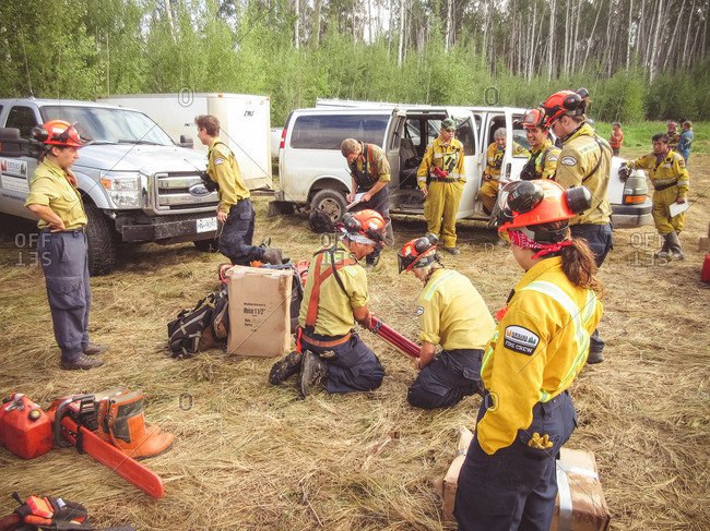 Alberta, British Colombia, Canada - July 13, 2015: Panorama Crew Services members gathering equipment and chainsaws, Alberta, British Colombia, Canada