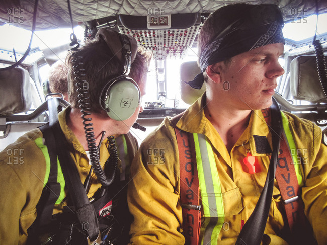 Alberta, British Colombia, Canada - July 13, 2015: Two male Panorama Crew Services members up in a helicopter, Alberta, British Colombia, Canada