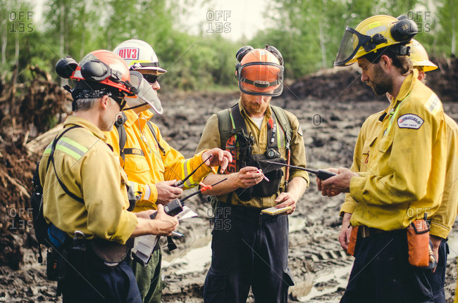 Alberta, British Colombia, Canada - July 13, 2015: Panorama Crew Services members with walkie talkies, Alberta, British Colombia, Canada