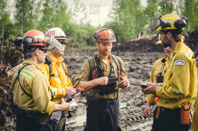 Alberta, British Colombia, Canada - July 13, 2015: Panorama Crew Services members discussing plan, Alberta, British Colombia, Canada