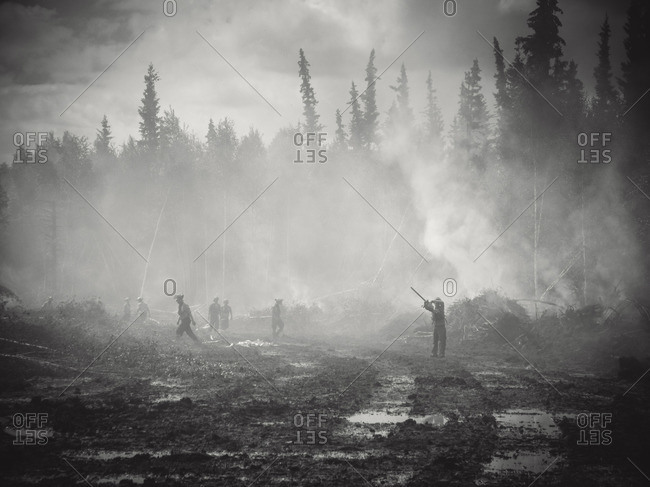 Alberta, British Colombia, Canada - July 13, 2015: Panorama Crew Services members on the scene of forest fire, Alberta, British Colombia, Canada