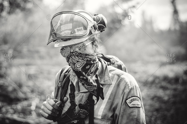 Alberta, British Colombia, Canada - July 13, 2015: Black and white portrait of Panorama Crew Services member with bandana covering face, Alberta, British Colombia, Canada