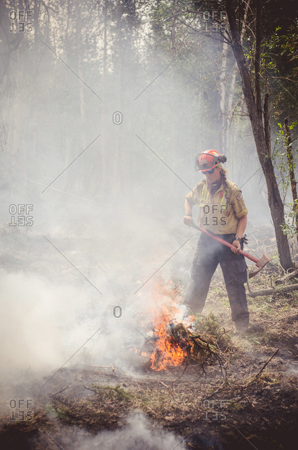 Alberta, British Colombia, Canada - July 16, 2015: Female member of Panorama Crew Services getting ready to swing axe, Alberta, British Colombia, Canada