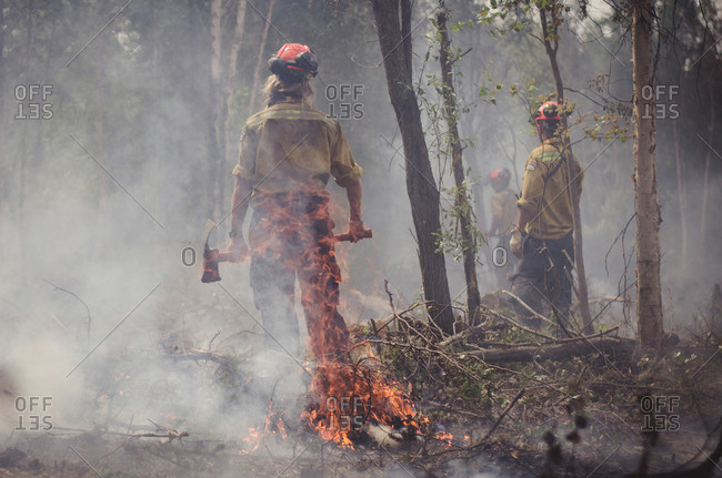 Alberta, British Colombia, Canada - July 16, 2015: Rear view of members of Panorama Crew Services standing behind flames, Alberta, British Colombia, Canada