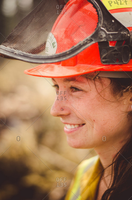 Alberta, British Colombia, Canada - July 16, 2015: Close up of a female Panorama Crew Services member smiling, British Colombia, Canada