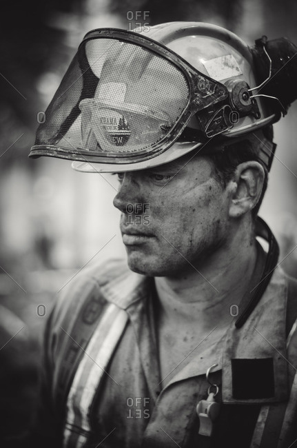 Alberta, British Colombia, Canada - July 16, 2015: Black and white portrait of a Panorama Crew Services member covered in soot, British Colombia, Canada
