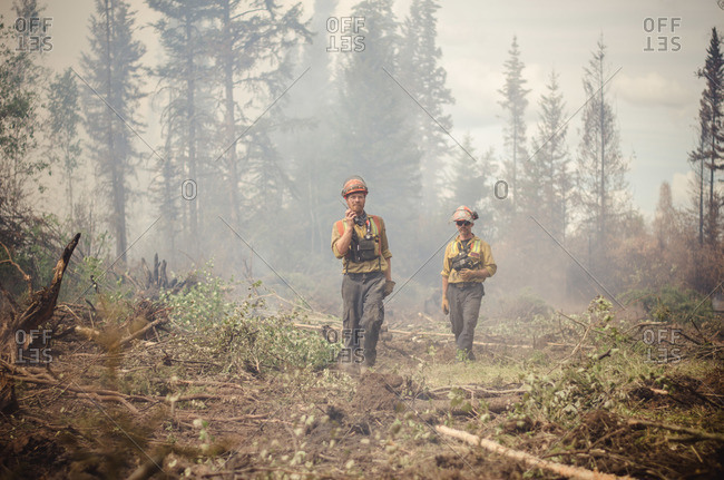 Alberta, British Colombia, Canada - July 16, 2015: Members of Panorama Crew Services asking for help on walkie talkie, Alberta, British Colombia, Canada