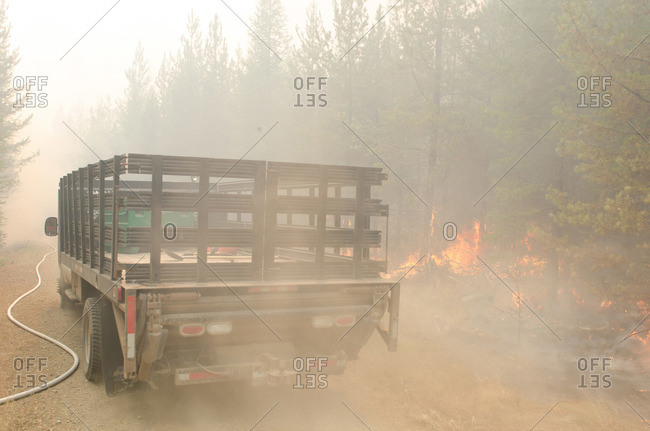 Alberta, British Colombia, Canada - July 27, 2015: Panorama Crew Services truck driving through forest fire, British Colombia, Canada