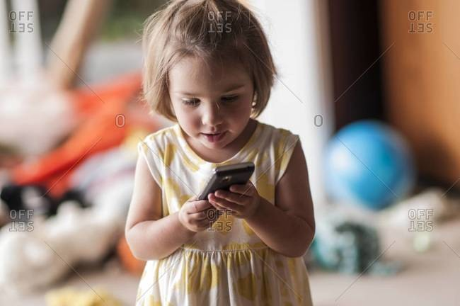 Young girl holding smart phone