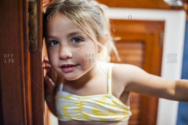 Close-up of young girl below deck on sailboat