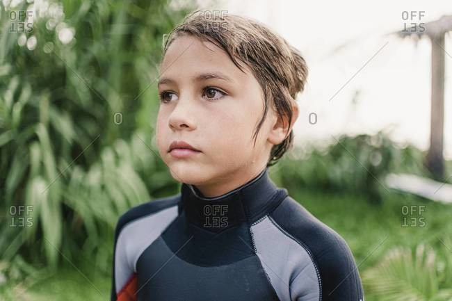 Portrait of young boy wearing wetsuit