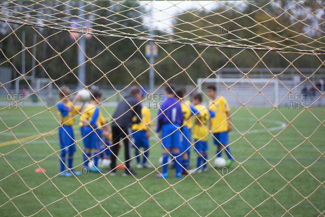 Boys playing soccer in a huddle