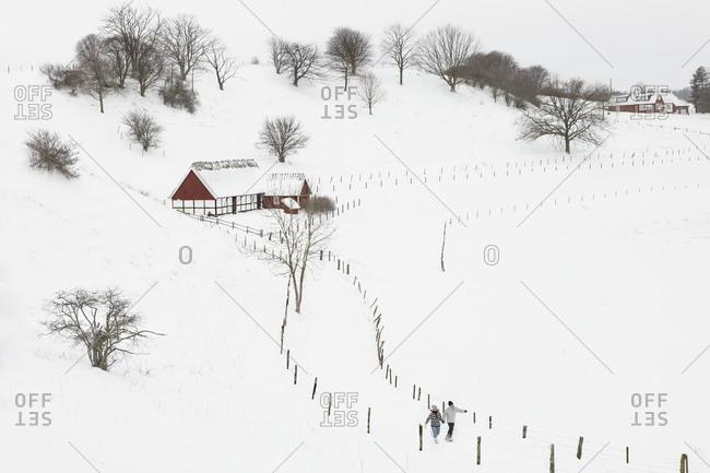 Couple walking in winter landscape