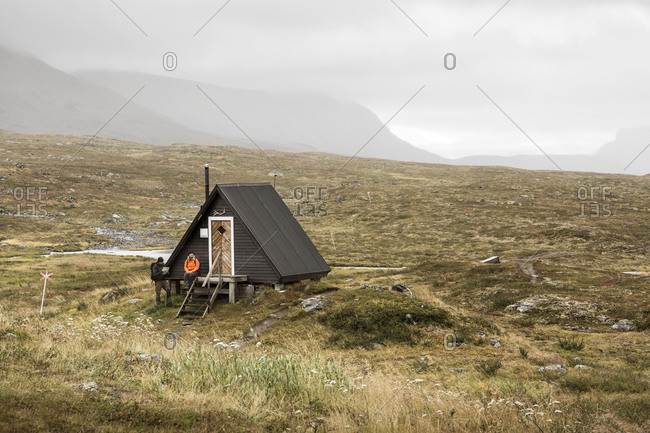 Couple near wooden building in mountains