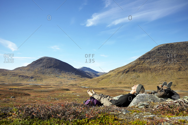 Woman relaxing in mountains, Jamtland