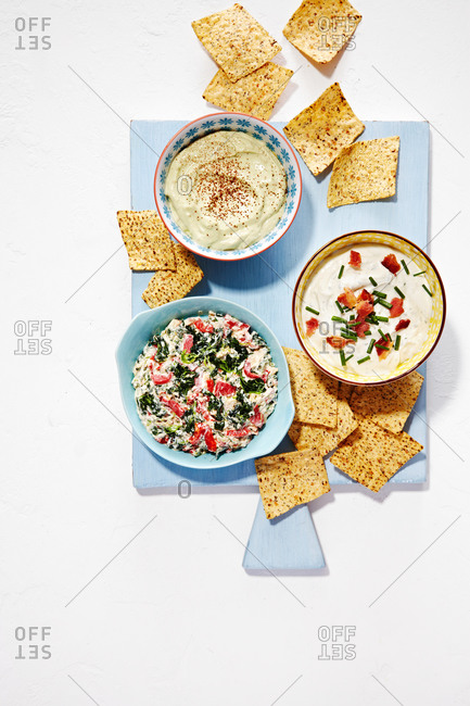 Bowls of veggie dip, ranch dip, and guacamole