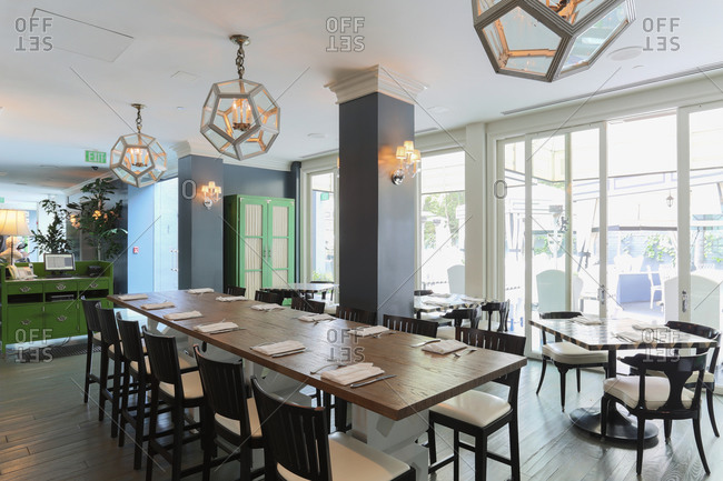 Santa Monica, CA - March 24, 2014: Interior of dining area in upscale restaurant showcase communal table