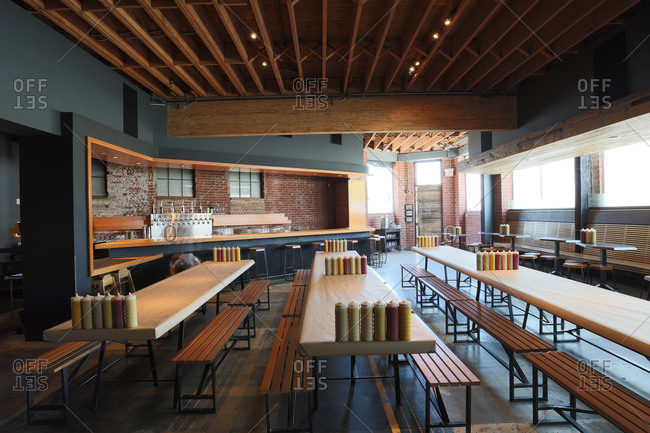 Los Angeles, CA - April 6, 2014: Interior of trendy hot dog restaurant with communal tables in Los Angeles