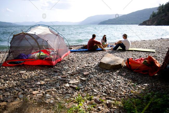 Friends camping along shore of Lake Pend Oreille, Idaho