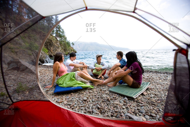 View from a red tent of friends camping on the shore of Lake Pend Oreille, Idaho