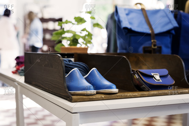 Blue shoes and handbags on display at a boutique store