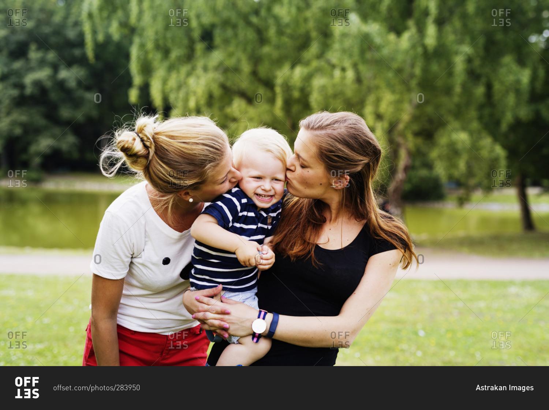 Two women giving little boy kiss in park stock photo offset two women giving little boy kiss in park thecheapjerseys Gallery