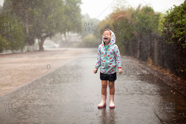 Girl sticking tongue out in the rain