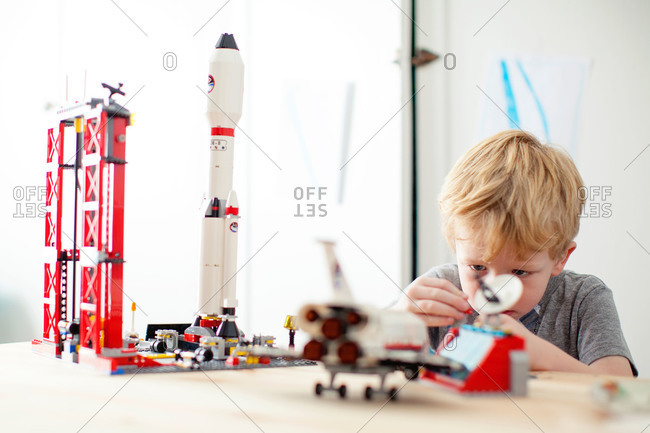 Boy playing with space toy set
