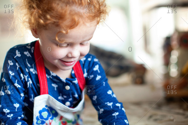 Portrait of girl making cookies in a kitchen