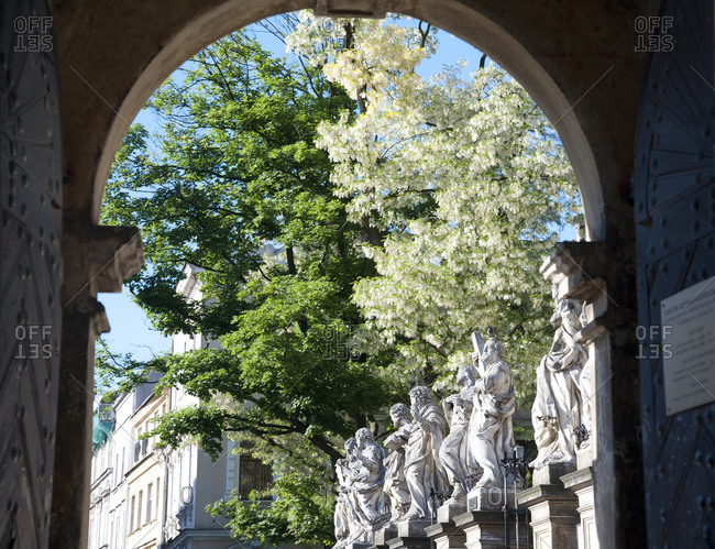 Statues of saints viewed through an archway at Church of Saints Peter and Paul in Krakow, Poland