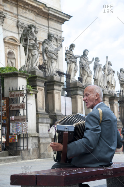 Krakow, Poland - May 27, 2011: Accordion player at the Church of Saints Peter and Paul