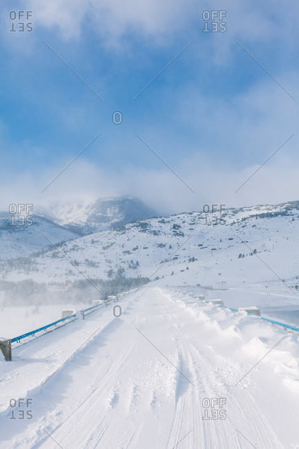 Snowy bridge during cold windy winter, Belmeken Dam, Rila Mountains, Bulgaria