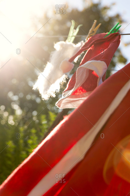 Santa costume handing on clothes line to dry