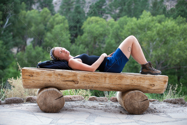 Woman relaxing on bench, New Mexico