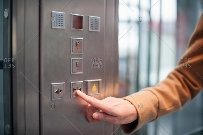 Woman pressing button of a lift