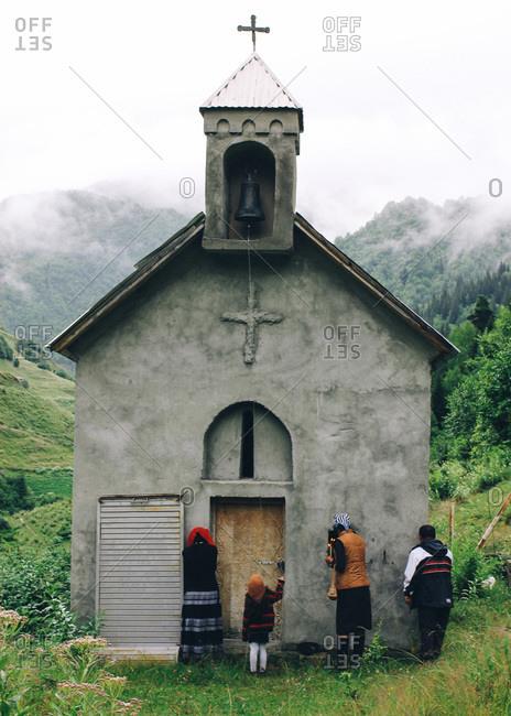 Villagers make their way to church in Kala, a tiny village in Svaneti Region, Georgia
