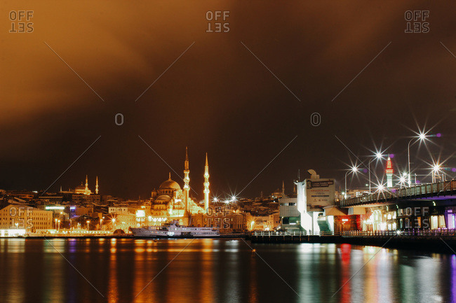 A view over the Galata Bridge towards the New Mosque as a snowstorm swells