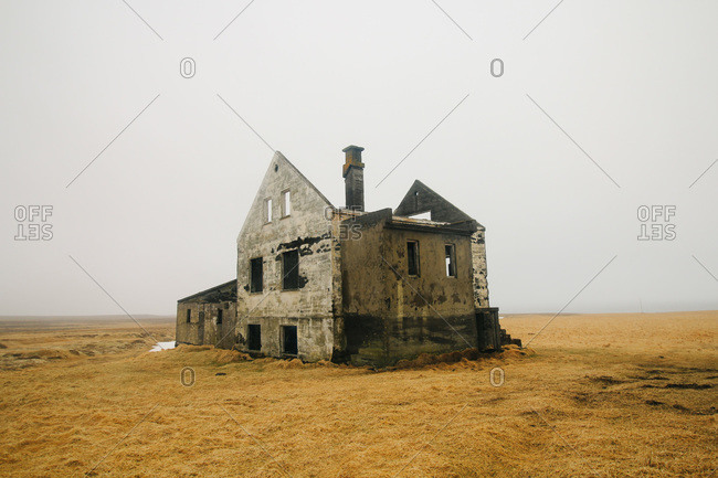 Fog envelops the remains of a homestead in the volcano fields on Snaefellsnes Peninsula, Iceland