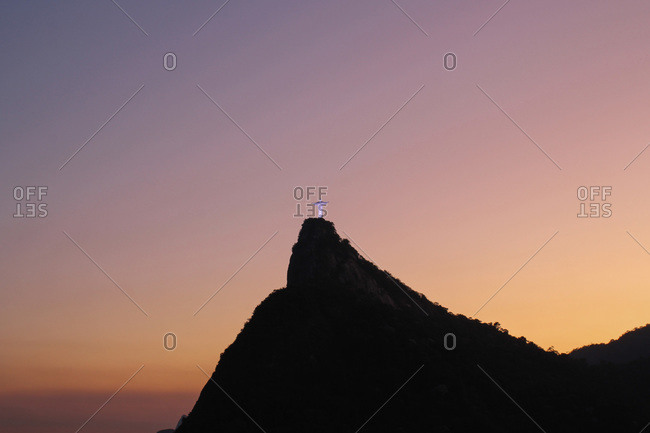Rio de Janeiro, Brazil - August 5, 2015: Corcovado mountain with the Christ the Redeemer statue at sunset in Brazil
