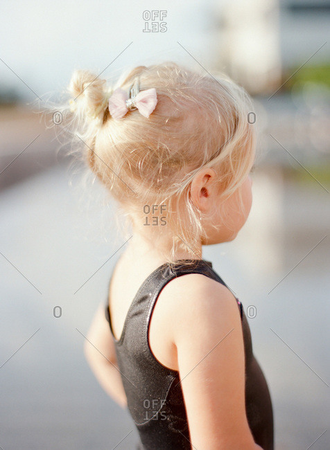Blonde girl with a bow in her hair