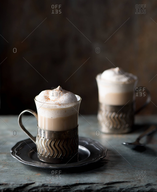 Studio shot of two coffees with whipped cream