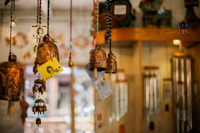 Metal bells and chimes hanging in a shop