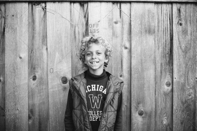 Black and white portrait of young boy with curly hair