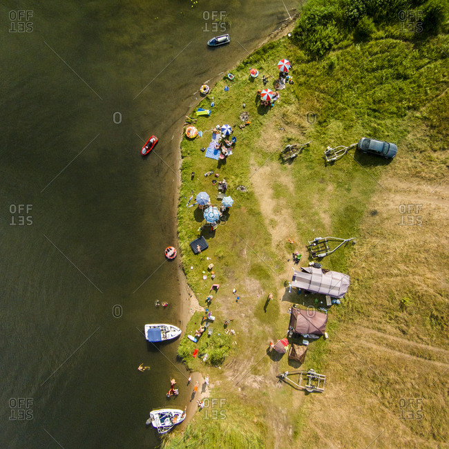 Boaters camping and picnicking on Elektrenai Lagoon in Pastrevys, Lithuania
