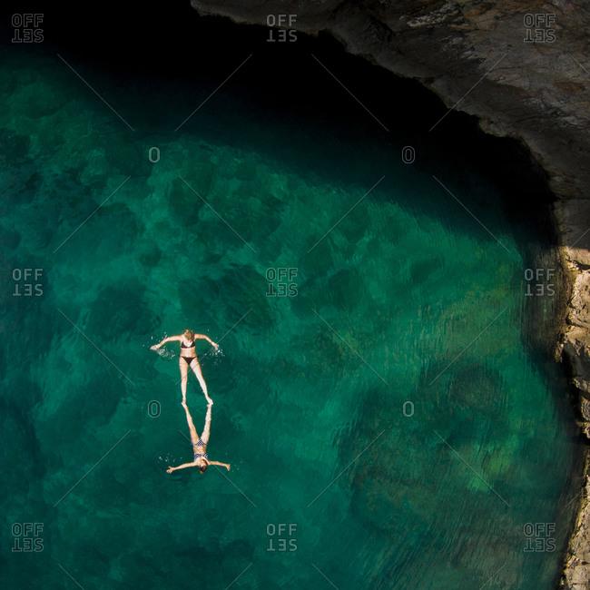 Women floating in the Adriatic Sea near island of Krk, Croatia