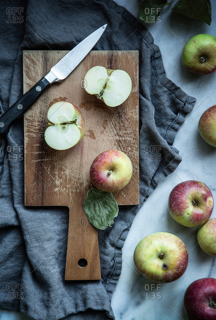 Fresh apples on a wooden cutting board