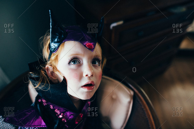 Young girl in makeup and Halloween costume