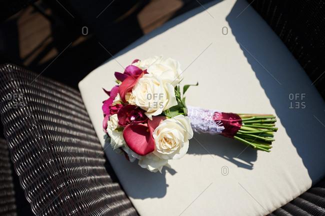 Bridal bouquet on a rattan chair