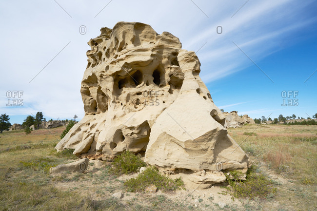 Large eroded rock formation in a field